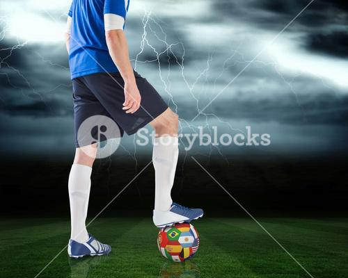 Football player standing with international ball