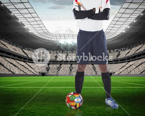 Goalkeeper standing with international ball