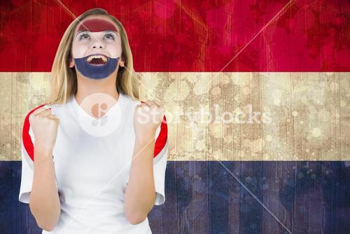 Excited netherlands fan in face paint cheering