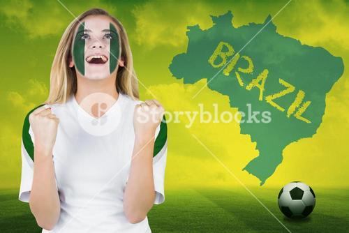 Excited nigeria fan in face paint cheering