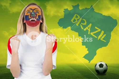 Excited ecuador fan in face paint cheering