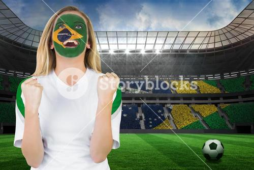 Excited brasil fan in face paint cheering