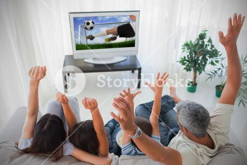 Family cheering and watching the world cup at home