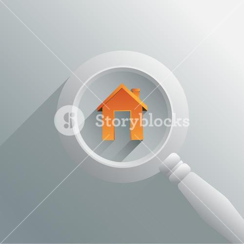 Magnifying glass over house graphic