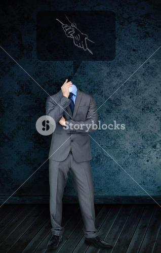 Composite image of headless businessman with handshake doodle