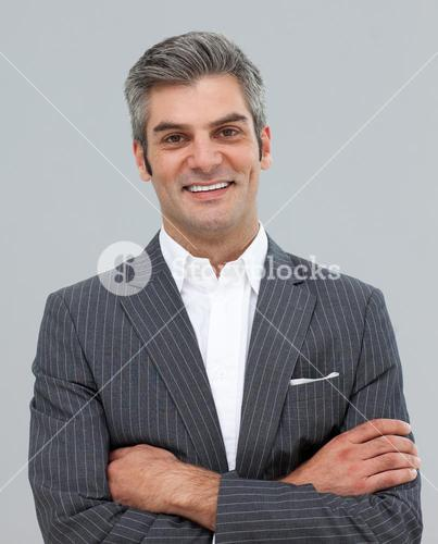 Mature businessman with folded arms