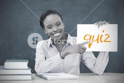 Happy teacher holding page showing quiz