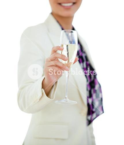 Businesswoman holding a glass