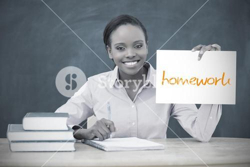 Happy teacher holding page showing homework