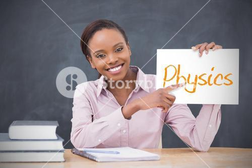 Happy teacher holding page showing physics