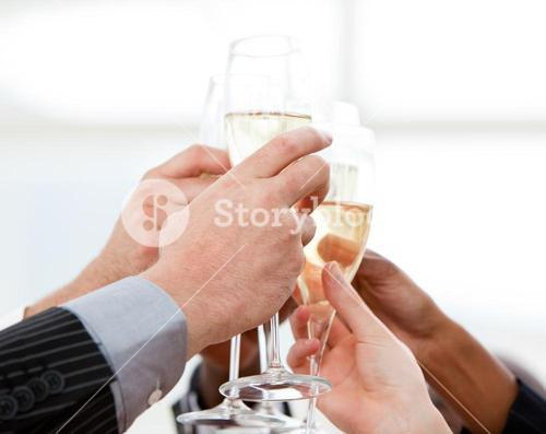 Close up of businessmen celebrating an event with champagne