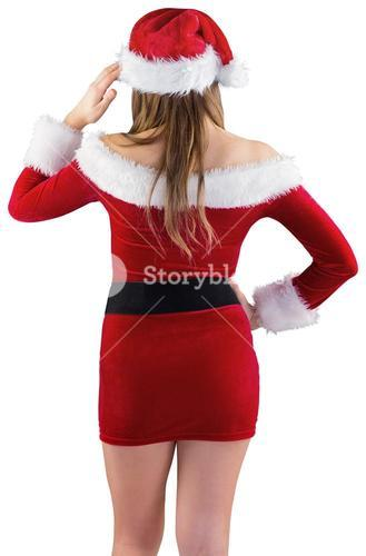Sexy santa girl with hand on hip