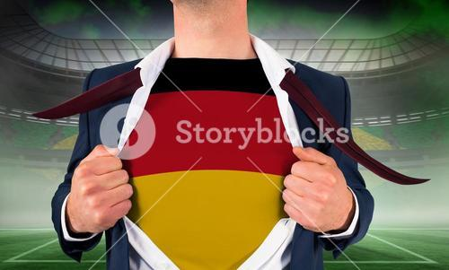 Businessman opening shirt to reveal germany flag