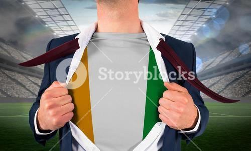 Businessman opening shirt to reveal ivory coast flag