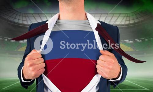 Businessman opening shirt to reveal russia flag