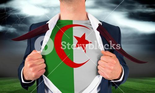 Businessman opening shirt to reveal algeria flag