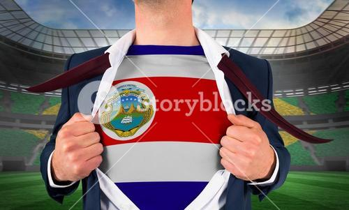 Businessman opening shirt to reveal costa rica flag