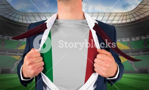 Businessman opening shirt to reveal italy flag