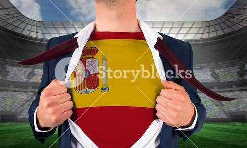 Businessman opening shirt to reveal spain flag