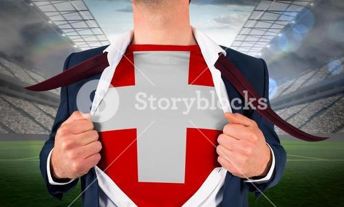 Businessman opening shirt to reveal swiss flag