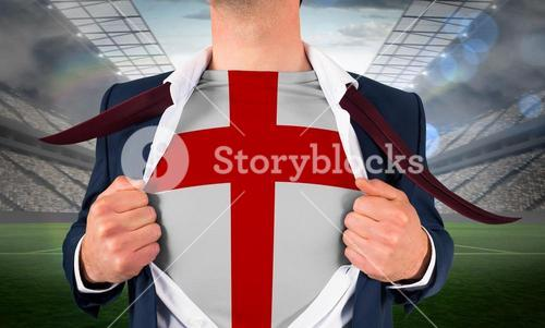 Businessman opening shirt to reveal england flag