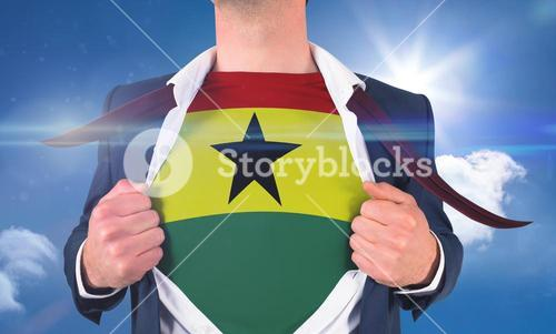 Businessman opening shirt to reveal ghana flag