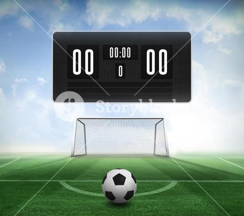 Black and white football and scoreboard