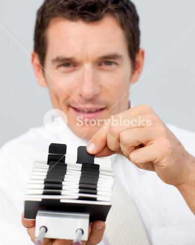 Attractive businessman holding a card holder