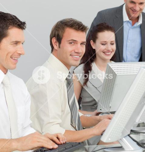 Businessman and his colleagues working with computers in an office