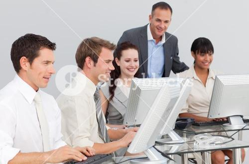 Business people and manager working with computers in an office