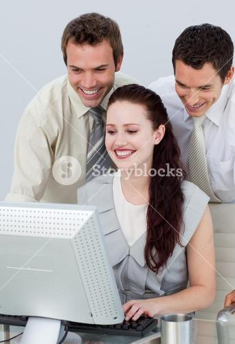 Businessmen helping her colleague with a computer