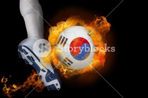 Football player kicking flaming korea republic ball