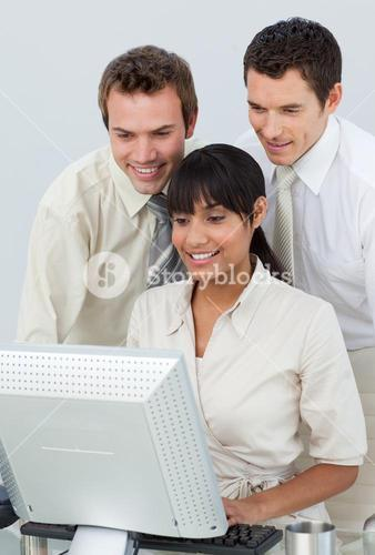 Businessmen and businesswoman working with a computer