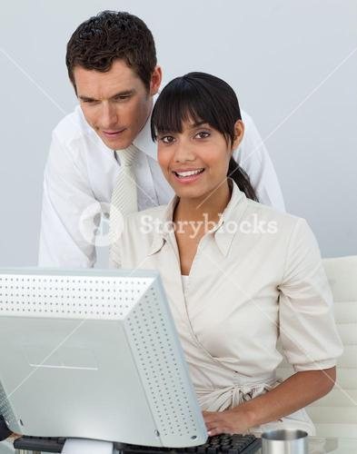 Smiling businesswoman with her colleague in the office