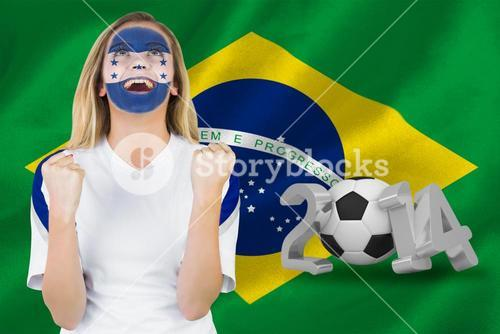 Excited honduras fan in face paint cheering