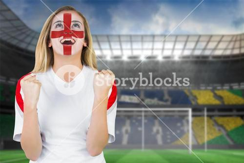 Excited fan england in face paint cheering