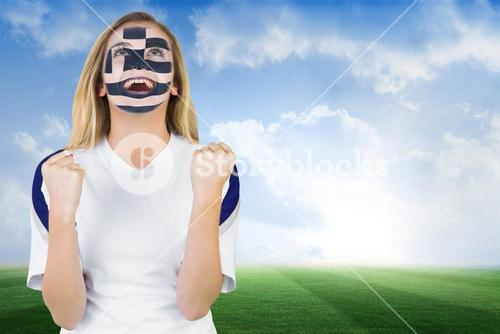 Excited greece fan in face paint cheering