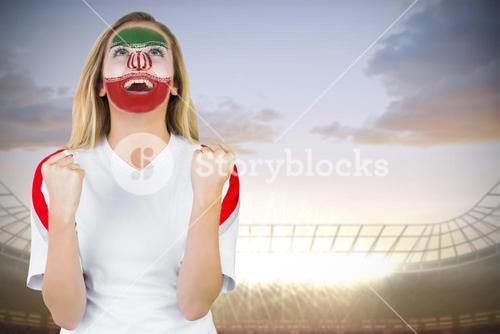Excited iran fan in face paint cheering