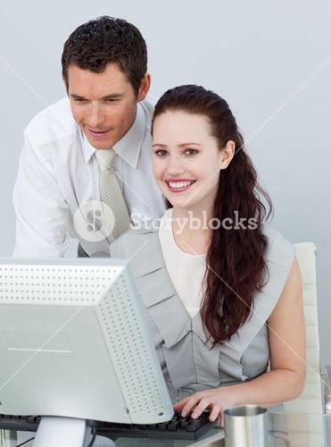 Businesswoman using a computer with her colleague