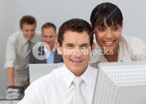 Businesswoman working with a businessman in the office
