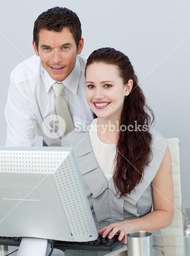 Businessman and businesswoman using a computer