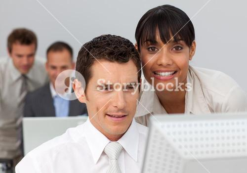 Businesswoman working with her colleague in the office