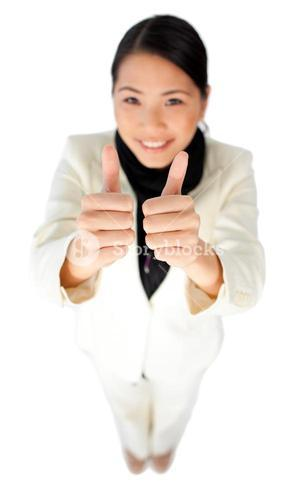 Attractive businesswoman with a thumbup