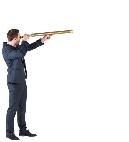 Businessman standing and looking through telescope