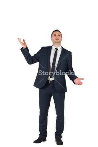 Businessman standing with hands outstretched