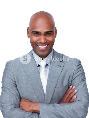 Confident businessman with folded arms