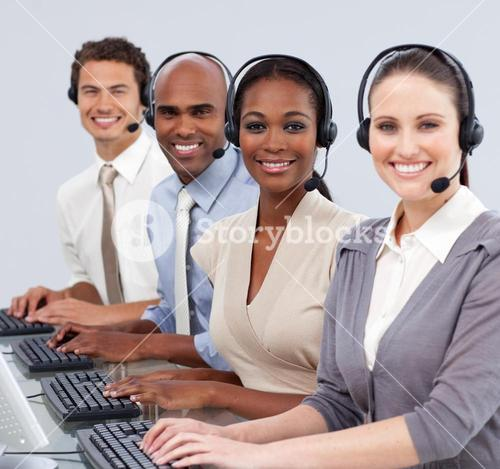 Business people with headset on in a call center