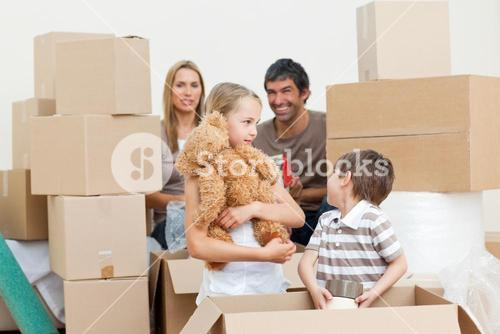 Family unpacking boxes after move in
