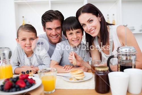 Family having healthy breakfast together