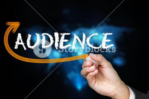 Businessman writing the word audience